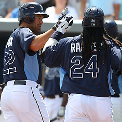 March 15, 2011; Port Charlotte, FL, USA; Tampa Bay Rays designated hitter Manny Ramirez (24) is celebrates with left fielder Johnny Damon (22) following a homerun during a spring training exhibition game against the Florida Marlins at Charlotte Sports Park.   Mandatory Credit: Derick E. Hingle