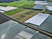 Nederland, Zuid-Holland, Bleiswijk, 14-09-2019; hogesnelheidslijn HSL doorsnijdt het kassengebied van Bleiswijk in de Overbuurtsche Polder.<br /> The rails of the HST between the greenhouses of the vegetables and fruit producers in the west of the Netherlands, skyline Rotterdam<br /> <br /> luchtfoto (toeslag op standard tarieven);<br /> aerial photo (additional fee required);<br /> copyright foto/photo Siebe Swart