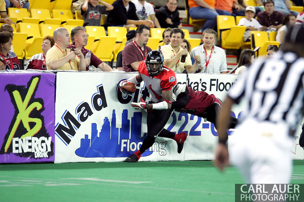6-28-2007: Anchorage, AK - Kendrick Wade (1) gets knocked into the boards as the CenTex Barracudas hand the Alaska Wild another loss 53-47 as the Barracudas make the trip up to Alaska.