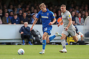 AFC Wimbledon attacker Marcus Forss (15) dribbling away from Portsmouth defender Lee Brown (3) during the EFL Sky Bet League 1 match between AFC Wimbledon and Portsmouth at the Cherry Red Records Stadium, Kingston, England on 19 October 2019.