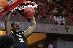 20 March 2017:  A.J. Davis inside of MiKyle McIntosh(11) to make a little jam during a College NIT (National Invitational Tournament) 2nd round mens basketball game between the UCF (University of Central Florida) Knights and Illinois State Redbirds in  Redbird Arena, Normal IL