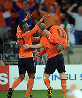 Durban World Cup 2010  Holland v Slovakia Match 53 28/06/10<br /> Wesley Sneijder (Holland) celebrates second goal with Dirk Kuyt  and eljero Elia<br /> Photo Roger Parker Fotosports International