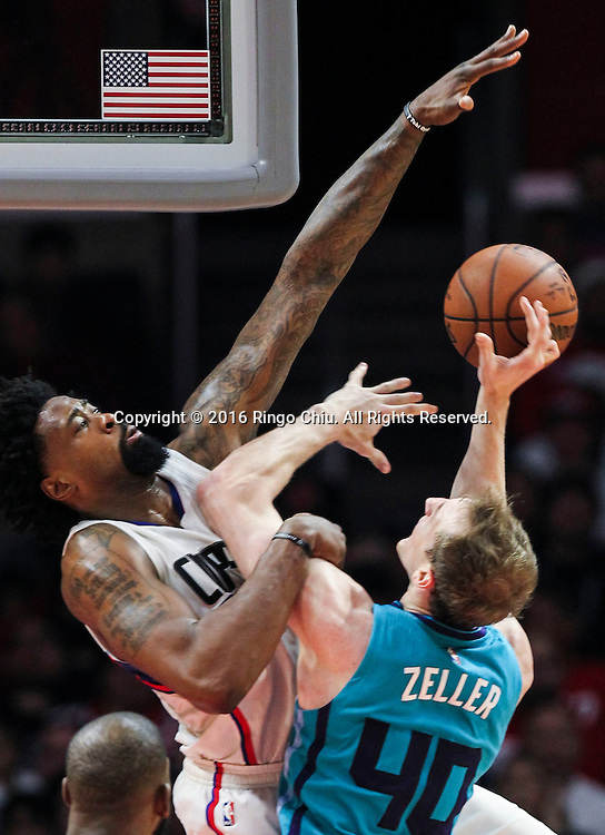Charlotte Hornets Cody Zeller goes up for a shot against Los Angeles Clippers DeAndre Jordan during the NBA basketball game against Charlotte Hornets in Los Angeles, the United States, Jan. 9, 2016. Los Angeles Clippers won 97-83. (Xinhua/Zhao Hanrong)(Photo by Ringo Chiu/PHOTOFORMULA.com)<br /> <br /> Usage Notes: This content is intended for editorial use only. For other uses, additional clearances may be required.