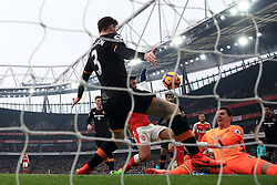 Arsenal's Alexis Sanchez scores his sides opening goal during the Premier League match at the Emirates Stadium, London.