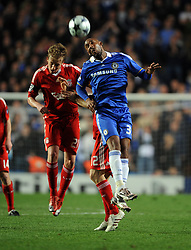 Nicolas Anelka of Chelsea  competes with Lucas of Liverpool during the UEFA Champions League Quarter Final Second Leg match between Chelsea and Liverpool at Stamford Bridge on April 14, 2009 in London, England.