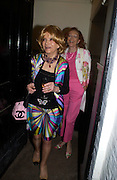 Lady Wyatt and Lady Marcelle Quinton. Spectator party. Doughty St. London. 28 July 2005. ONE TIME USE ONLY - DO NOT ARCHIVE  © Copyright Photograph by Dafydd Jones 66 Stockwell Park Rd. London SW9 0DA Tel 020 7733 0108 www.dafjones.com