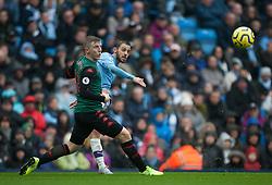 Bernardo Silva of Manchester City (R) crosses the ball - Mandatory by-line: Jack Phillips/JMP - 26/10/2019 - FOOTBALL - Etihad Stadium - Manchester, England - Manchester City v Aston Villa - English Premier League