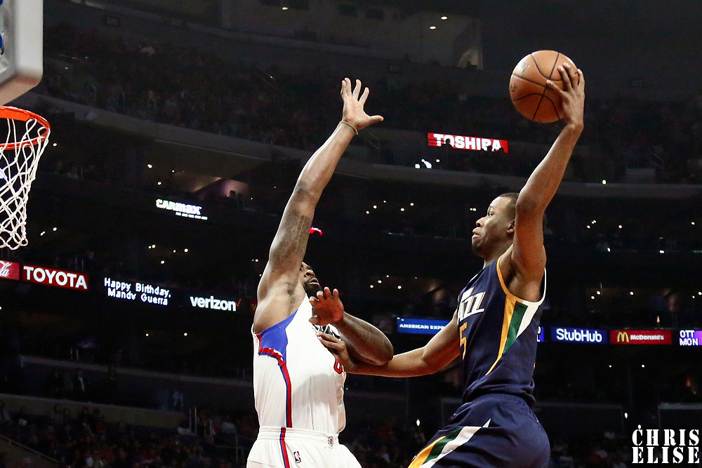 25 March 2016: Utah Jazz guard Rodney Hood (5) goes for the dunk against LA Clippers center DeAndre Jordan (6) during the Los Angeles Clippers 108-95 victory over the Utah Jazz, at the Staples Center, Los Angeles, California, USA.
