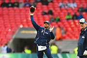 Seattle Seahawks quarterback Russell Wilson warms up before the game during the International Series match between Oakland Raiders and Seattle Seahawks at Wembley Stadium, London, England on 14 October 2018.