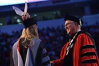 Chancellor Randy Woodson congratulates a new doctor on her degree.