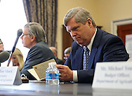 Agriculture Secretary Tom Vilsack looks over his notecards before the start of a hearing before the House Appropriations Agriculture subcommittee on the USDA's fiscal 2014 budget proposal in the Rayburn House Office Building in Washington, DC on Tuesday, April 16, 2013.