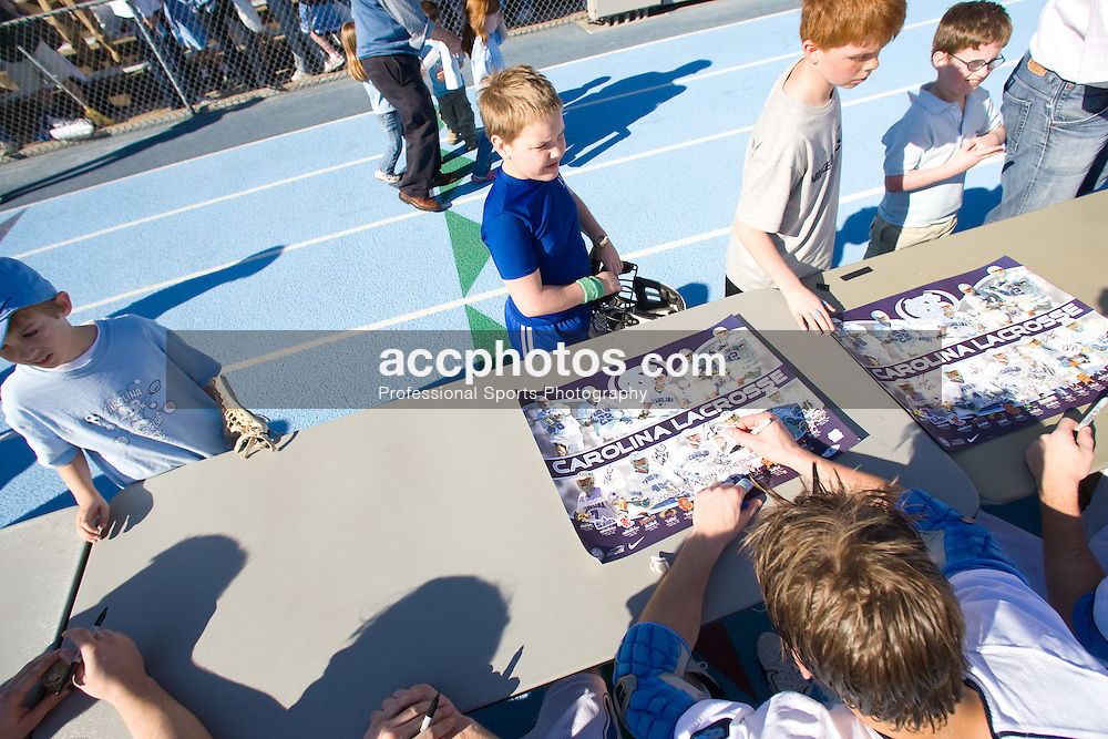 02 March 2008: North Carolina Tar Heels midfielder Ben Hunt (18) signs autographs for fans after a 13-8 win over the Cornell Big Red on Fetzer Field in Chapel Hill, NC.