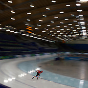 Winter Olympics, Vancouver, 2010.An athlete from Switzerland training at the Speed Skating venue at Richmond Oval in preparation for the Long Track Speed Skating event at the Winter Olympics. 8th February 2010. Photo Tim Clayton