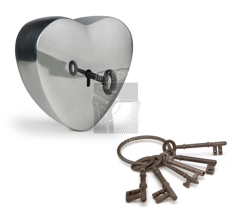 key unlocking a metal heart
