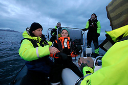 NORWAY ANDENES 8DEC15 - Greenpeace campaigners Christian Bussau (L) and Larissa Baeumer of Germany during a whale research boat trip off the coast of Andenes, Norway.<br /> <br /> jre/Photo by Jiri Rezac / Greenpeace<br /> <br /> © Jiri Rezac 2015