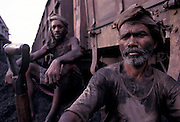 INDIA: Varanasi.Railway workers covered in dirt and grime from arduous labour conditions