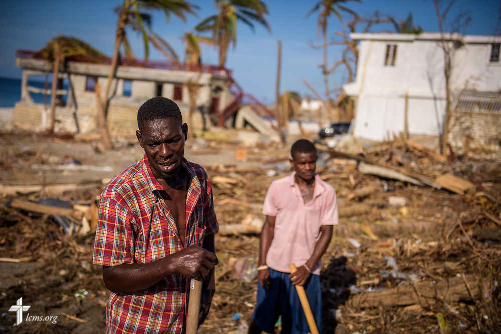 Men clear debris caused by Hurricane Matthew on Wednesday, Oct. 12, 2016, in Port-Salut, Haiti. LCMS Communications/Erik M. Lunsford