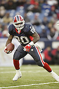 Bills running back Travis Henry (20) looks for running room while rushing for only 67 yards on 24 carries during a 20 to 3  win by the Miami Dolphins over the Buffalo Bills in an NFL Week 16 game in Buffalo on December 21, 2003. ©Paul Anthony Spinelli