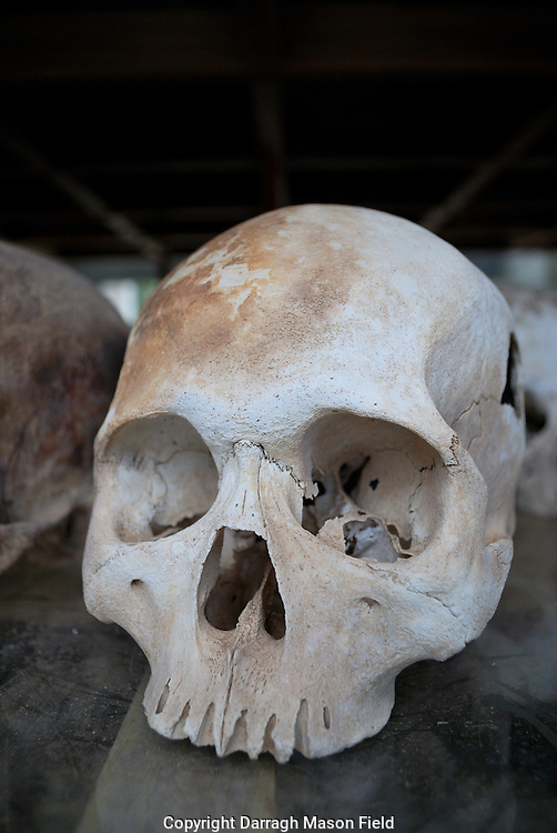Skulls of young adults, victims of the Khmer Rouge.  The Skull has a hole on the right from a blow.