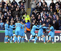 Spurs players and fans celebrate Tottenham Hotspur's second goal - Photo mandatory by-line: Joe Meredith/JMP - Tel: Mobile: 07966 386802 19/01/2014 - SPORT - FOOTBALL - Liberty Stadium - Swansea - Swansea City v Tottenham Hotspur - Barclays Premier League