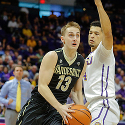 Feb 20, 2018; Baton Rouge, LA, USA; Vanderbilt Commodores guard Riley LaChance (13) drives past LSU Tigers guard Skylar Mays (4) during the first half at the Pete Maravich Assembly Center. Mandatory Credit: Derick E. Hingle-USA TODAY Sports