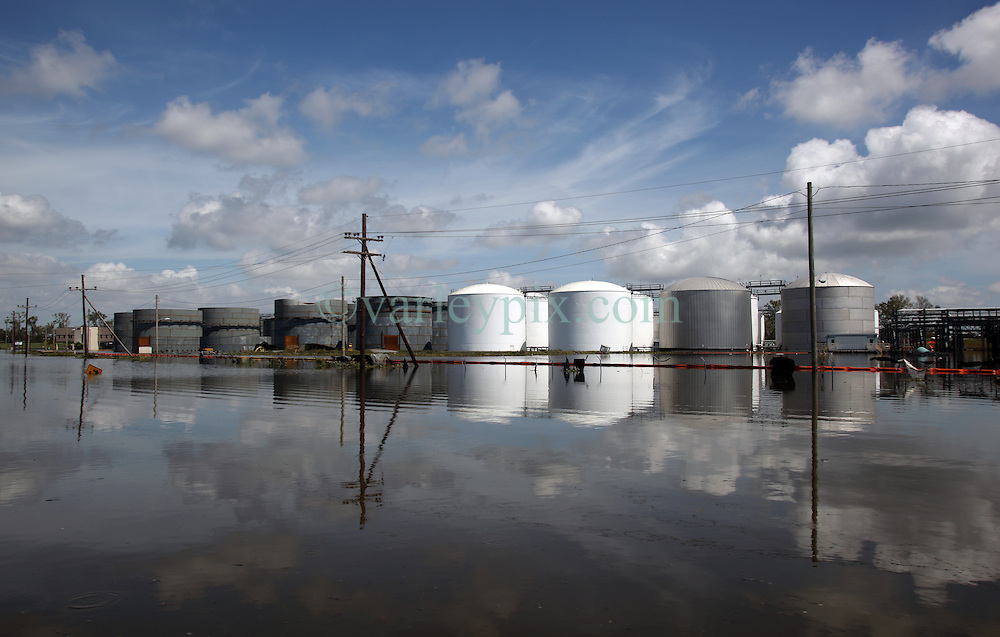 01 September 2012. Braithwaite, Plaquemines Parish, Louisiana,  USA. .Stolthaven Chemical Plant. Scenes from the submerged town of Braithwaite following hurricane Isaac. A chemical storage terminal and rail carriages lie under water amidst fears the town could be subject to toxic leaks. .Photo; Charlie Varley.