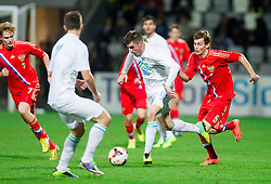 Enej Jelenic of Slovenia vs Andrey Semenov of Russia during football match between U21 National Teams of Slovenia and Russia in 6th Round of U21 Euro 2015 Qualifications on November 15, 2013 in Stadium Bonifika, Koper, Slovenia. Russia defeated Slovenia 1-0. Photo by Vid Ponikvar / Sportida