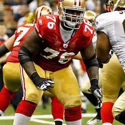 August 12, 2011; New Orleans, LA, USA; San Francisco 49ers offensive tackle Anthony Davis (76) works against New Orleans Saints defensive end Will Smith (91) during the first half of a preseason game at the Louisiana Superdome. Mandatory Credit: Derick E. Hingle