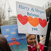 London, England, UK. 9th January 2018. A ladies holding a banner during Prince Harry and Meghan Markle visit Reprezent 107.3FM Radio station.