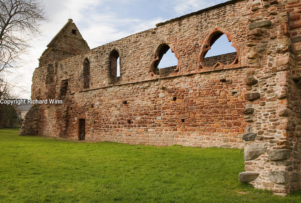 Side view of the ruins of Beauly Priory in Inverness-Shire, Scotland. Many priories in England, Scotland and Wales were left to decay after the dissolution by King Henry VIII.