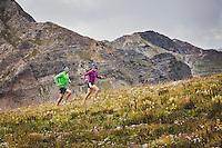 Katie Franzmann and Jon Brown running near Scarps Ridge, Crested Butte, Colorado.