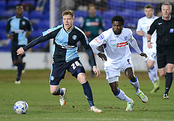 Wycombe Wanderers's Alfie Mawson competes with Tranmere Rovers's Kayode Odejayi - Photo mandatory by-line: Richard Martin-Roberts/JMP - Mobile: 07966 386802 - 03/03/2015 - SPORT - football - Tranmere - Prenton Park - Tranmere Rovers v Wycombe Wanderers - Sky Bet League Two