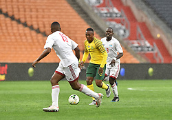 South Africa: Johannesburg: Bafana Bafana player Lebohang Maboe challenges Bertrand Esther of  Seychelles during the Africa Cup Of Nations qualifiers at FNB stadium, Gauteng.<br />