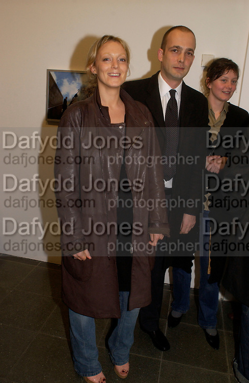 Phoebe Philo and Max Wigram, State of Play opening,  Serpentine Gallery, 2 February 2004. © Copyright Photograph by Dafydd Jones 66 Stockwell Park Rd. London SW9 0DA Tel 020 7733 0108 www.dafjones.com