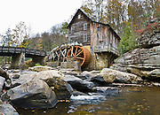 Babcock State Park is located along the New River Gorge in Fayette County, West Virginia, USA. Located near the park headquarters, the Glade Creek Grist Mill is among the most photographed tourist sites in the state of West Virginia. The Glade Creek Grist Mill is a replica of the original Cooper's Mill that was located nearby. The current grist mill, completed in 1976, was assembled from parts of three other West Virginia mills. The Glade Creek Grist Mill as a living, working monument to the more than 500 mills formerly running throughout the state. Panorama stitched from 4 overlapping photos.