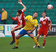 Whitehawk defender Juan Cruz Gotta & Lincoln City striker Matt Rhead battle for possession during the The FA Cup match between Whitehawk FC and Lincoln City at the Enclosed Ground, Whitehawk, United Kingdom on 8 November 2015. Photo by Bennett Dean.