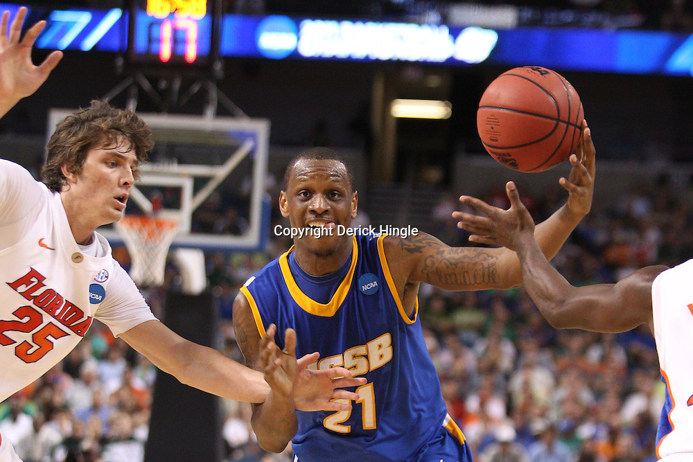 Mar 17, 2011; Tampa, FL, USA; UC Santa Barbara Gauchos forward James Nunnally (21) drives past Florida Gators forward Chandler Parsons (25) during second half of the second round of the 2011 NCAA men's basketball tournament at the St. Pete Times Forum. Florida defeated UCSB 79-51.  Mandatory Credit: Derick E. Hingle