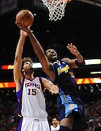 Mar. 10, 2011; Phoenix, AZ, USA; Denver Nuggets center Nene (31) puts up a basket against the Phoenix Suns center Robin Lopez (15) at the US Airways Center. Mandatory Credit: Jennifer Stewart-US PRESSWIRE
