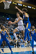 UCLA Bruins guard Jules Bernard (3) drives to the basket against San Jose State Spartans forward Craig LeCesne (25) during an NCAA college basketball game, Sunday, Dec. 1, 2019, in Los Angeles. UCLA defeated San Jose State 93-64. (Jon Endow/Image of Sport)