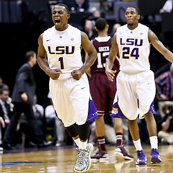 Jan 23, 2013; Baton Rouge, LA, USA; LSU Tigers guard Anthony Hickey (1) reacts after hitting a shot at the end of the first half of a game against the Texas A&M Aggies at the Pete Maravich Assembly Center. Mandatory Credit: Derick E. Hingle-USA TODAY Sports