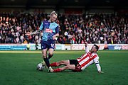 Jack Grimmer of Wycombe Wanderers is foul by Aidan McGeady of Sunderland sliding tackle during the EFL Sky Bet League 1 match between Wycombe Wanderers and Sunderland at Adams Park, High Wycombe, England on 19 October 2019.