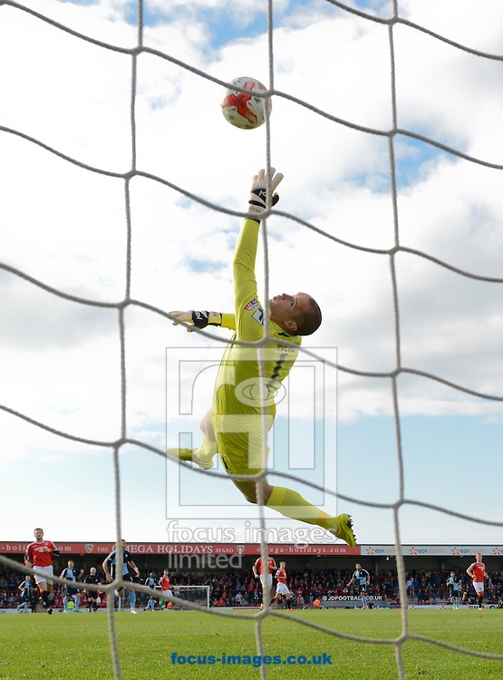 A long range effort by Sam Wood of Wycombe Wanderers travels over Morecambe goalkeeper Barry Roche to make it 1-0 during the Sky Bet League 2 match at the Globe Arena, Morecambe<br /> Picture by Russell Hart/Focus Images Ltd 07791 688 420<br /> 11/10/2014