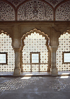 Carved windows in indo islamic style in room interior of the Amber palace.