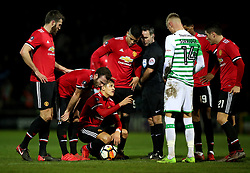 Manchester United's Alexis Sanchez (bottom) before a free-kick during the Emirates FA Cup, fourth round match at Huish Park, Yeovil.
