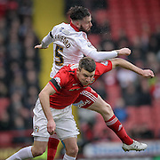 John Brayford (Sheffield United) jumps over Chris Stokes (Coventry City) during the Sky Bet League 1 match between Sheffield Utd and Coventry City at Bramall Lane, Sheffield, England on 13 December 2015. Photo by Mark P Doherty.