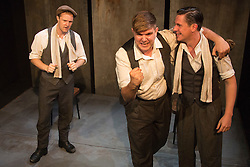 © Licensed to London News Pictures. 28/07/2015. London, UK. L-R: Paul Tinto (Phil), Kieran Knowles (Tommy) and James Wallwork (Arthur). World premiere of the play Operation Crucible at the Finborough Theatre. The play commemorates the 75th anniversary of the Sheffield Blitz and the 70th anniversary of the end of the Second World War with four men trapped in the rubble. The play by Kieran Knowles and directed by Bryony Shanahan runs at the Finborough Theatre from 28 July to 22 August 2015. With Salvatore D'Aquilla, Kieran Knowles, Paul Tinto and James Wallwork. Photo credit: Bettina Strenske/LNP