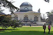 © Licensed to London News Pictures. 25/04/2013. Chiswick, UK People walk in the shady trees in front of Chiswick House. People enjoy the sunshine in the grounds of Chiswick House in West London today 25th April 2013. Photo credit : Stephen Simpson/LNP