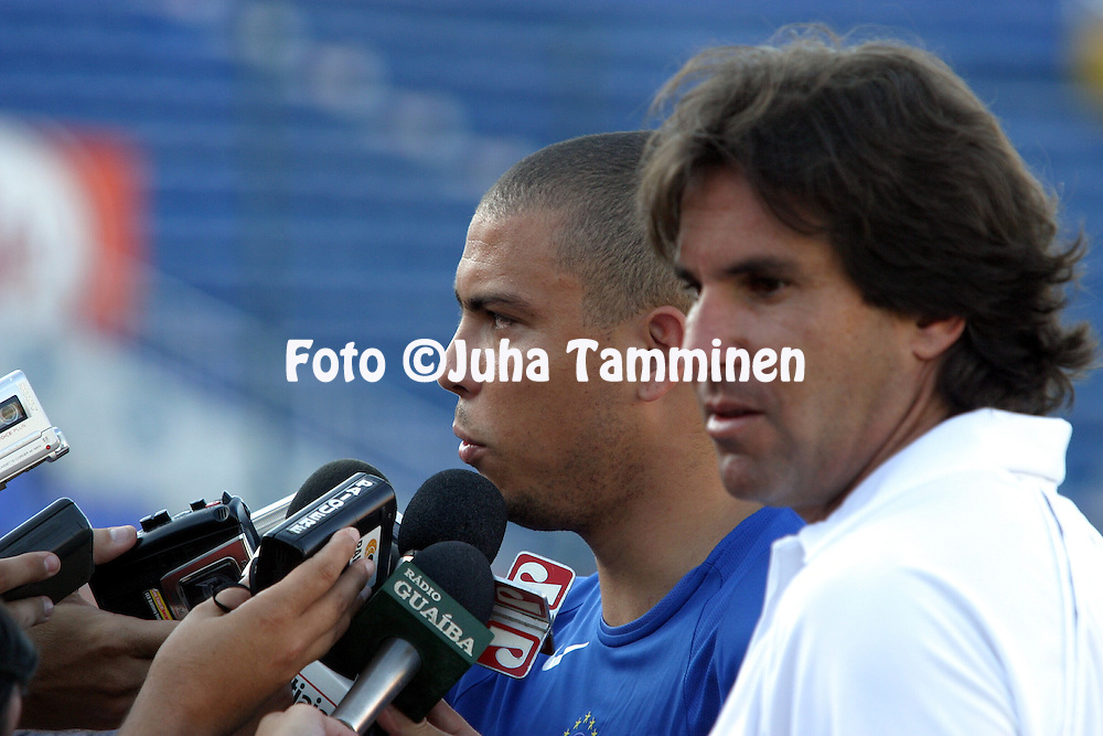 30.03.2004, Estadio de los Defensores del Chaco, Asunci--n, Paraguay..The training session of the Brazilian National Team prior to the FIFA World Cup 2006 qualifying match v Paraguay..Ronaldo being interviewed by the press before the training session, watched by the team's press officer Rodrigo Santos Paiva..Full name: Ronaldo Lu's Naz?rio de Lima.©Juha Tamminen