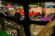 """Jacob Hinkle, 13, socializes with friends and family members before the demolition derby at the Summitt County Fairgrounds, Thursday, July 26, 2016 in Tallmadge, Ohio. This will be Jacob's first race, and he """" ... doesn't feel nervous at all."""""""