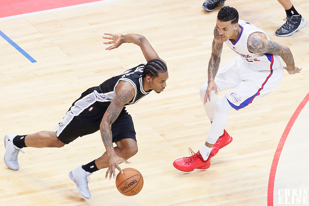 19 April 2014: San Antonio Spurs forward Kawhi Leonard (2) drives past Los Angeles Clippers forward Matt Barnes (22) during the Los Angeles Clippers 107-92 victory over the San Antonio Spurs, during Game One of the Western Conference Quarterfinals of the NBA Playoffs, at the Staples Center, Los Angeles, California, USA.